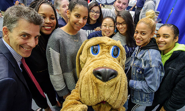 John Jay Students with mascot the Bloodhound